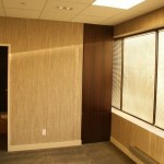 Wall Panel Conceals Closet and Safe