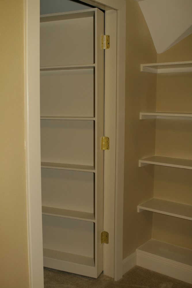 Moving bookcase hidden door