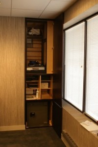 Wall Panel Opens to Closet and Safe