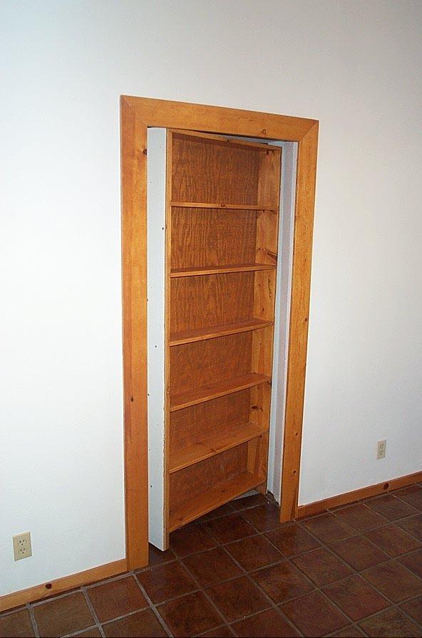 Secret Room Concealed by Bookcase Door