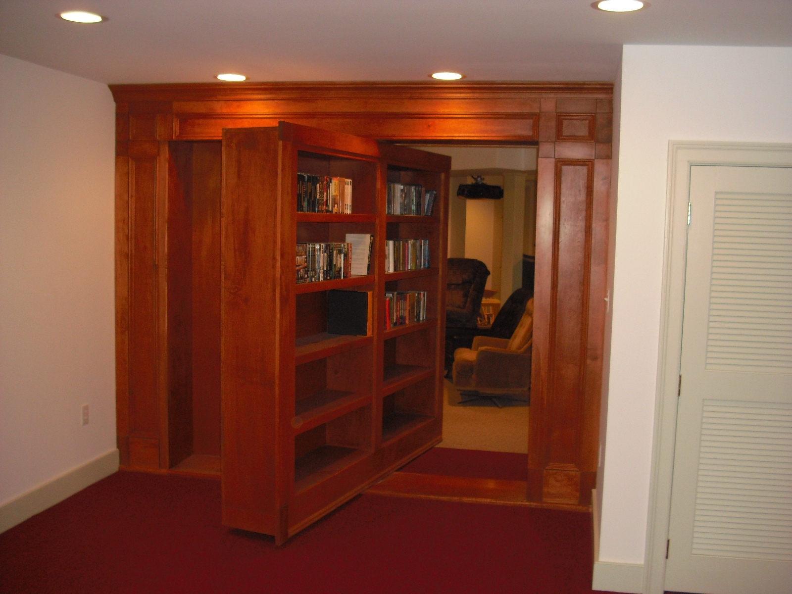 Rotating bookcase door stashvault - Room e ...