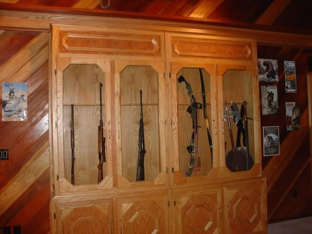 Sliding gun cabinet door stashvault for Hidden gun room