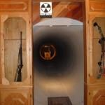 Gun Cabinet Door Reveals Hidden Firing Range