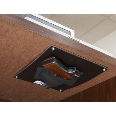 This Gun Holster Mounts Under A Desk And Leaves A Pistol Available For