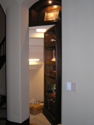 Hidden Room Concealed by Bookshelf Door