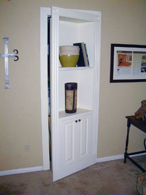 Doors in in dallas texas made this bookcase door to conceal a hidden