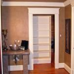 Caster Wheels Allow This Bookshelf Door to Push Straight Back