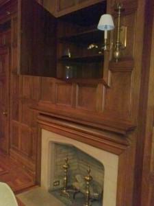 Door Opens To Reveal Secret Cabinet Above Fireplace