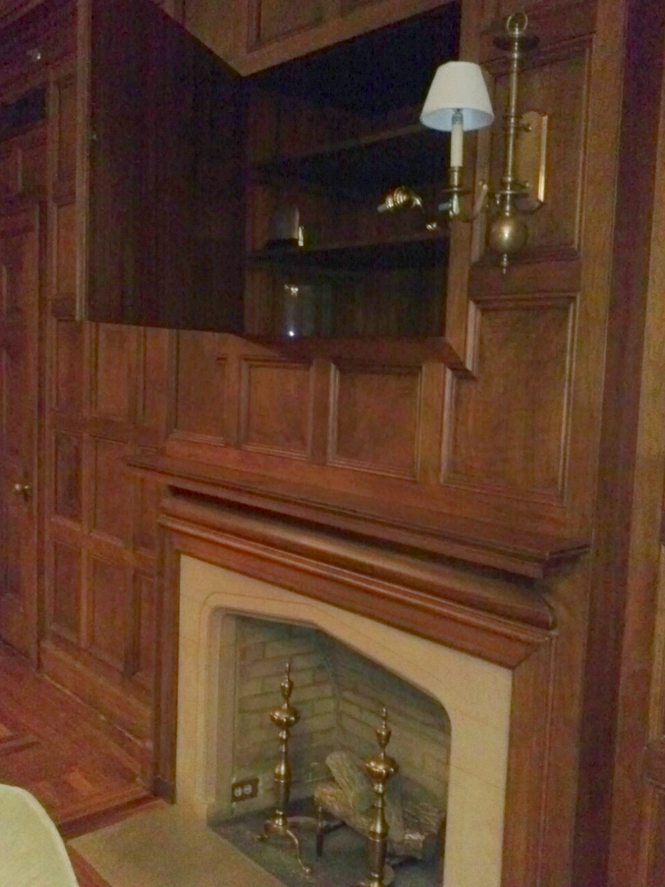 Secret Cabinet Behind Panel Above Fireplace