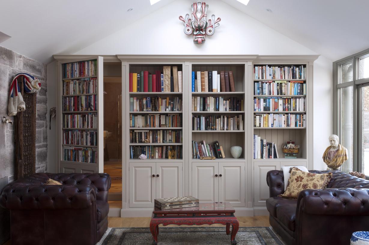How to build a secret passageway with the hidden door hinge system thrillist - Secret keys contemporary living room design ...