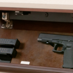 Hand Gun in Secret Shelf Compartment
