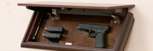 Hand Gun in Secret Shelf Compartment