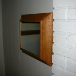 Wooden Mirror Conceals Secret Gun Storage