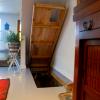 Trap Door in Floor Opens to Stairs
