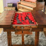 Table Opens to Reveal Firearms Inside