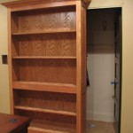 Bookcase Slides to Reveal Hidden Gun Storage