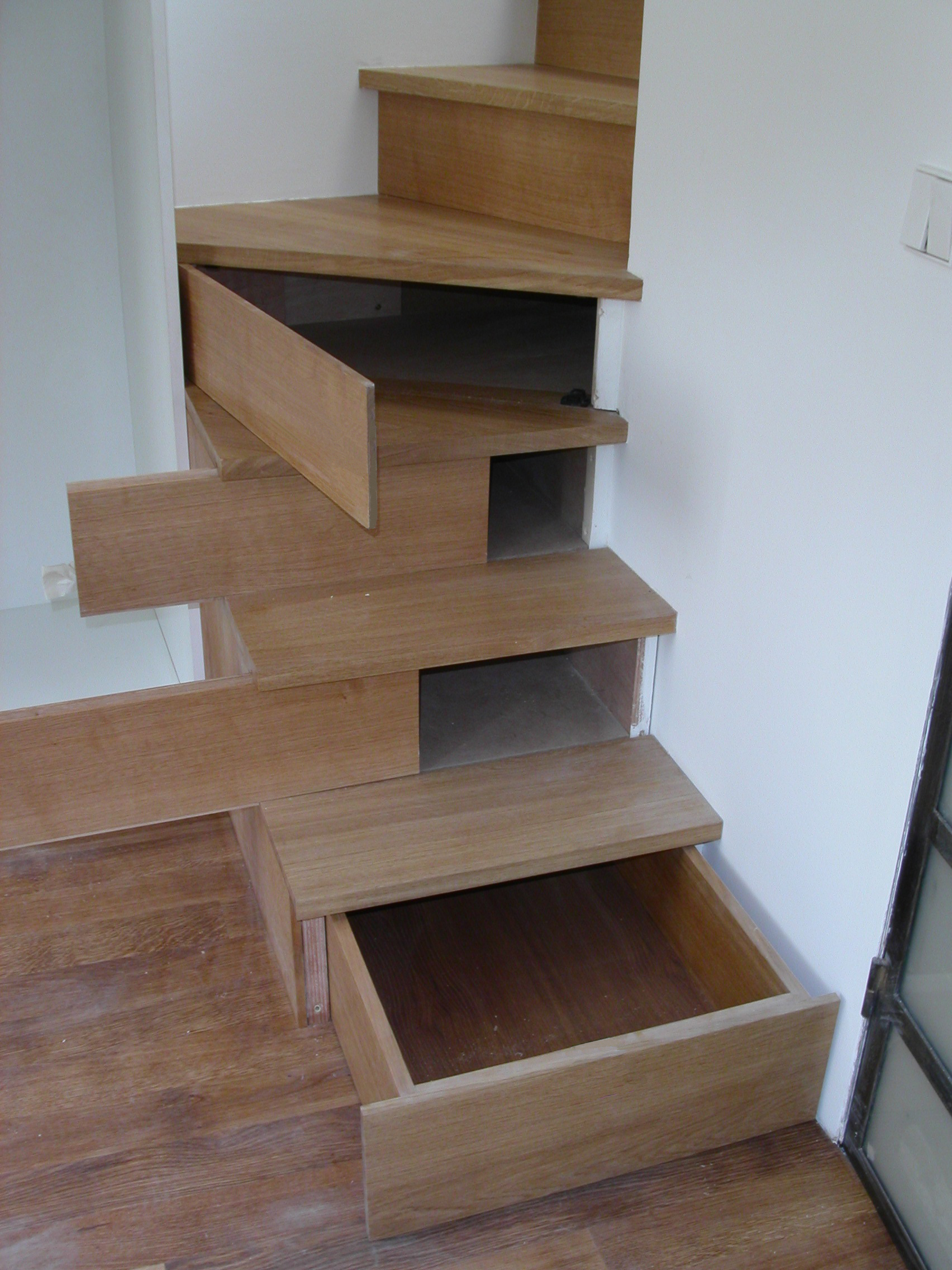 custom stairs incorporate hidden storage in the lower four stairs