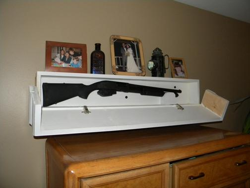 Long Gun in Secret Shelf Compartment