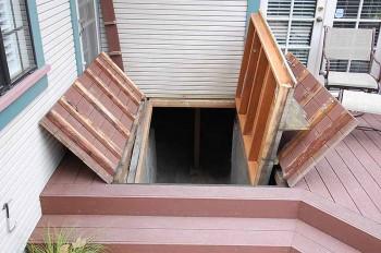 Cellar Accessed Under Hidden Door in Deck