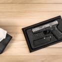 Pistol Beneath Tissue Box